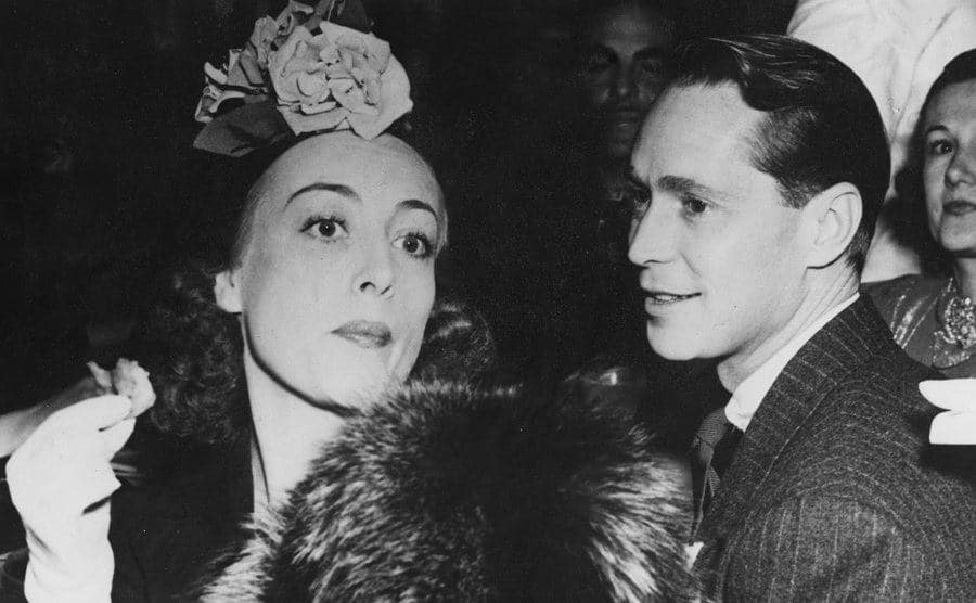 Joan Crawford and Franchot Tone during a party.