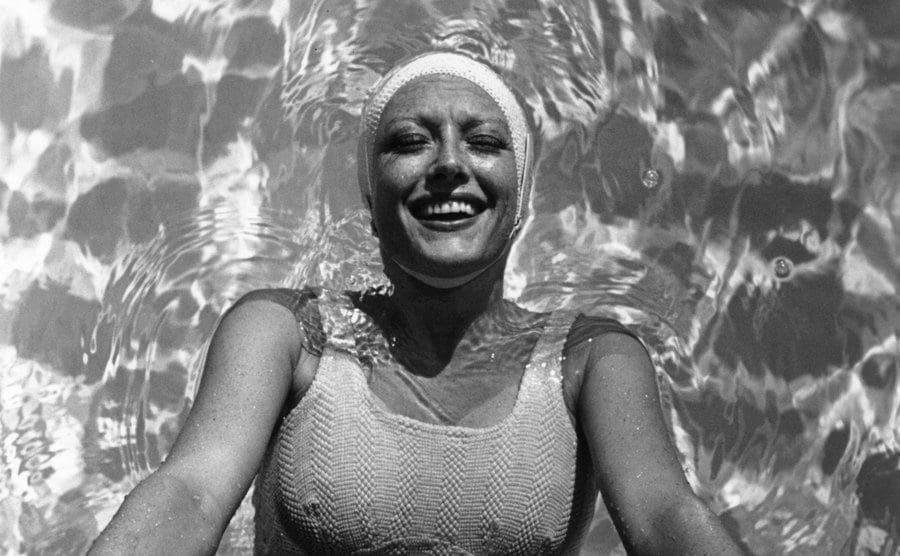 Joan Crawford in her swimming pool.