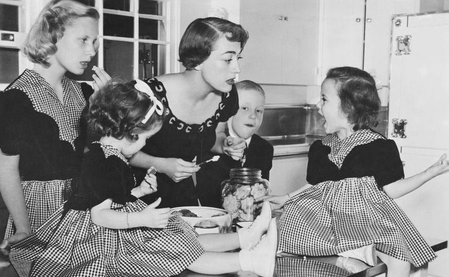 Crawford and her children are eating in the kitchen.