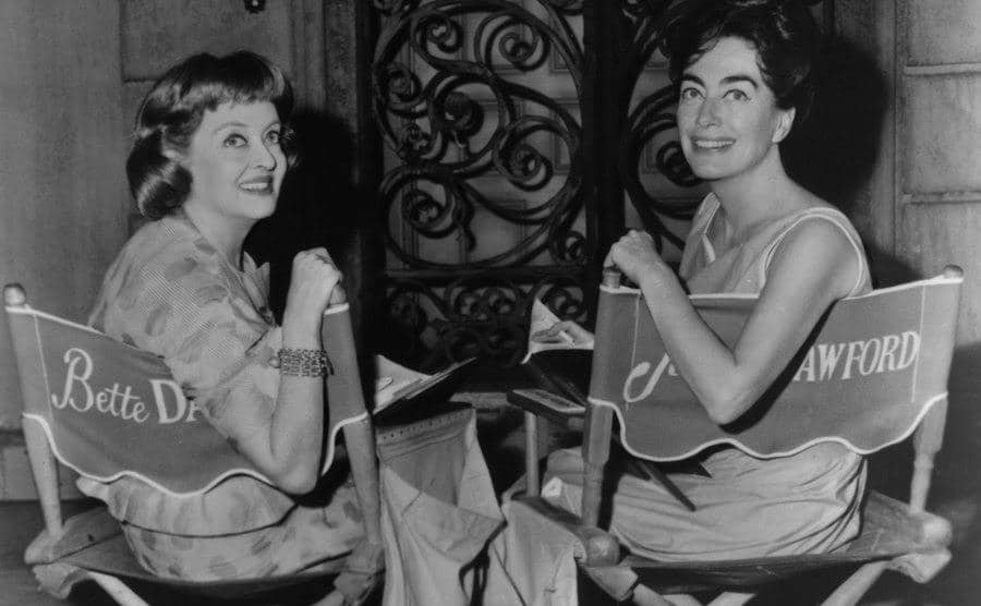 A picture of Bette Davis and Joan Crawford behind the scenes.