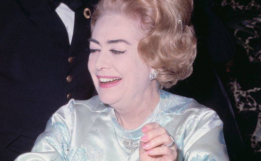 Joan Crawford during a formal dinner.