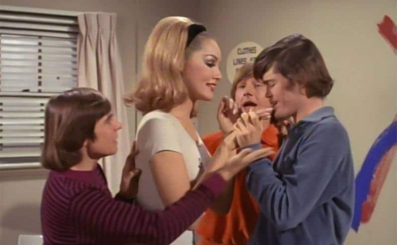 Monkees' three leading men surround ALT Julie Newmar.