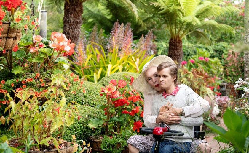 Julie Newmar and son John Jewel Smith in their garden.