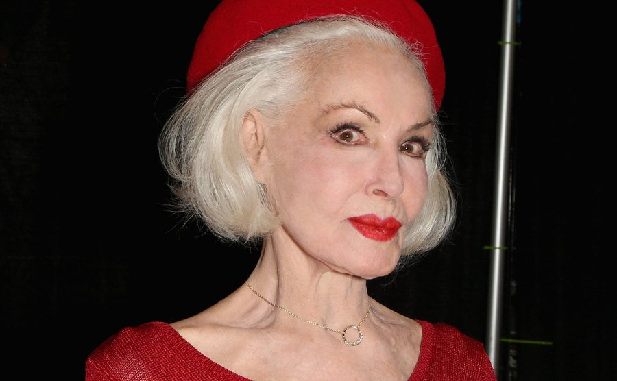 Julie Newmar is wearing all red at the Amazing Las Vegas Comic-Con.