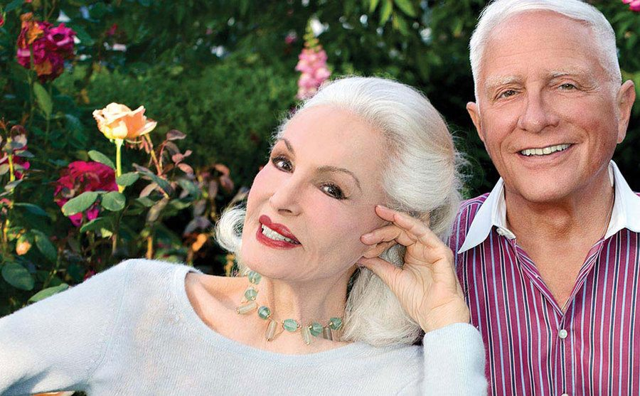 Julie Newmar and her brother John Newmeyer are smiling side by side.