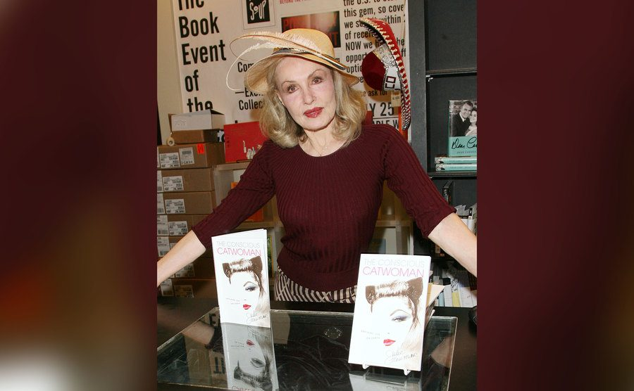 Julie Newmar signs copies of her new book.