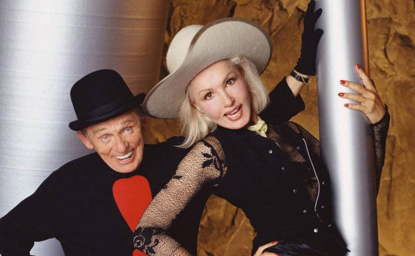 Frank Gorshin and Julie Newmar posing in the film.
