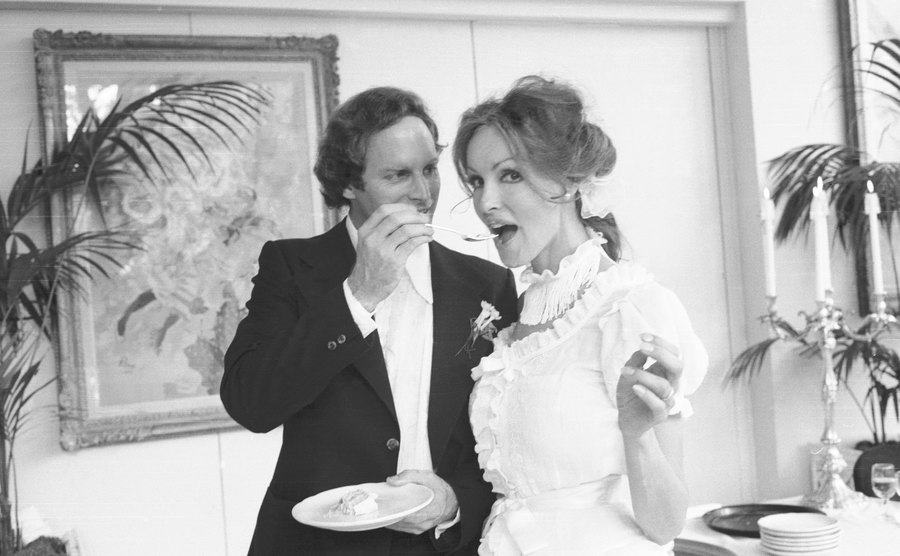 J. Holt Smith feeds Julie cake at the reception following their wedding.