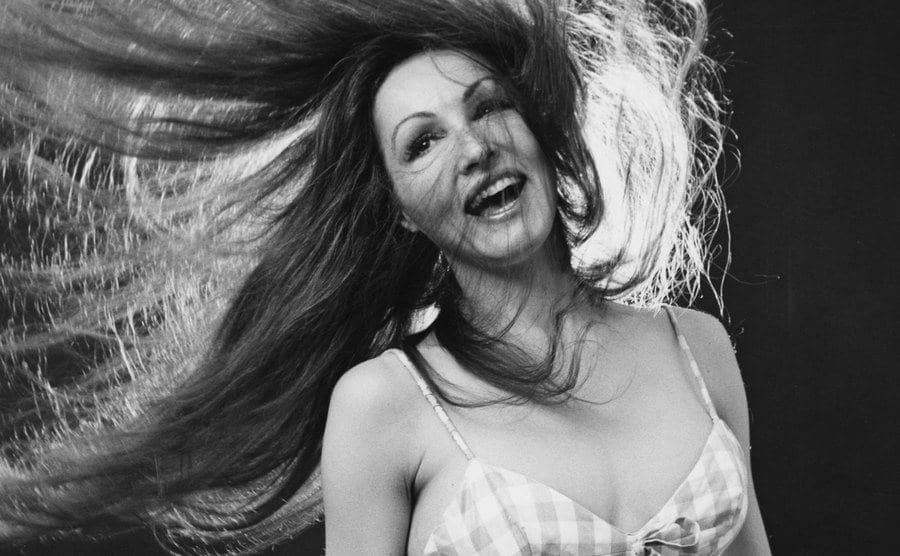 Julie Newmar is tossing her hair around in a photoshoot in 1974.