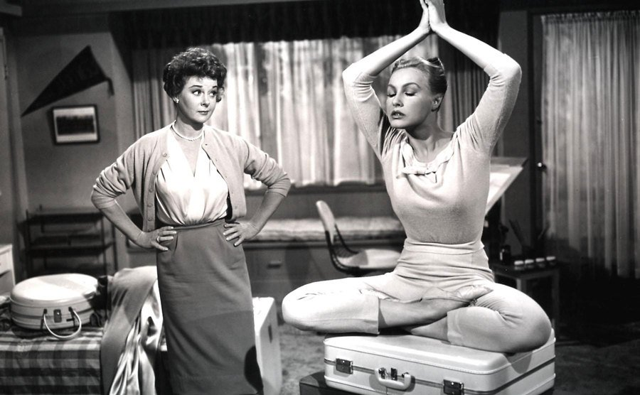 Julie Newmar is posing as a genie in The Marriage-Go-Round.