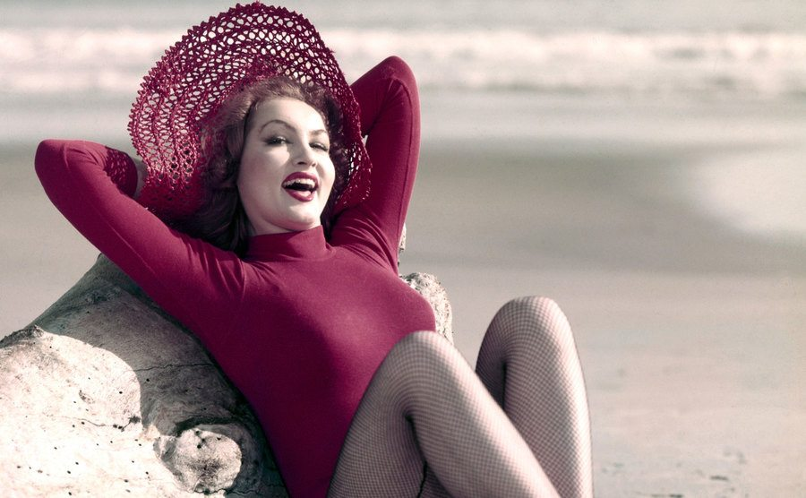 Julie Newmar posed on the beach in 1960.