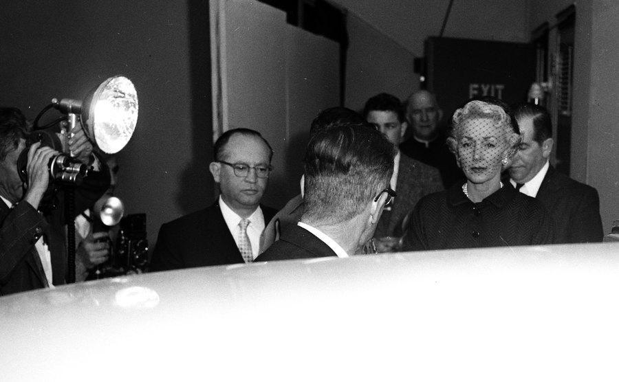 Mrs. Joan Cohn is going to Harry Cohn's funeral.