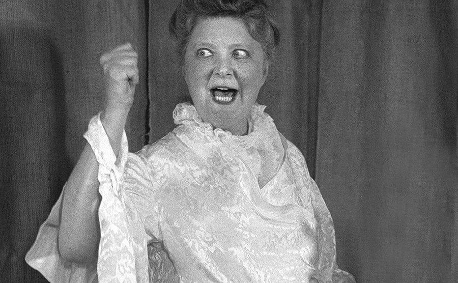 An actress impersonates Lizzie Borden.