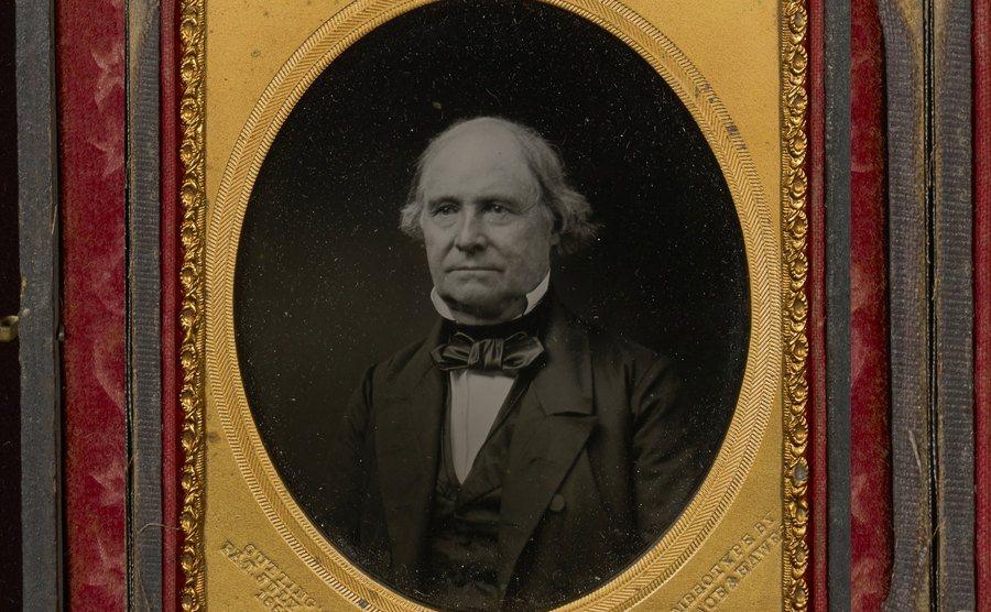A framed portrait of Andrew Borden.
