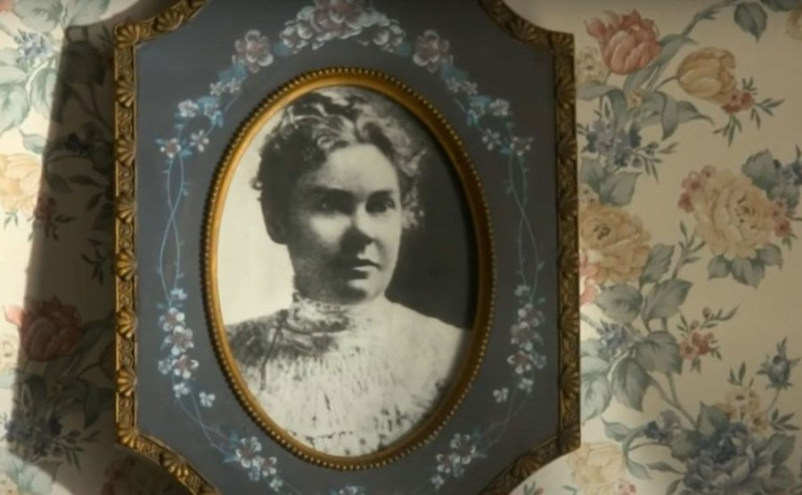 A framed portrait of Lizzie Borden hangs on her home.