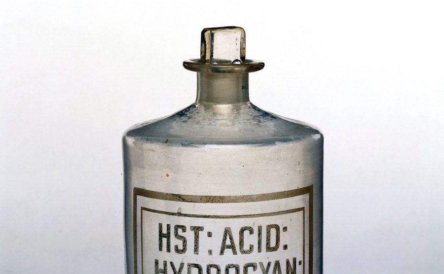 A bottle of acid.