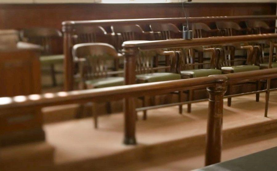 Empty jury seats in court.