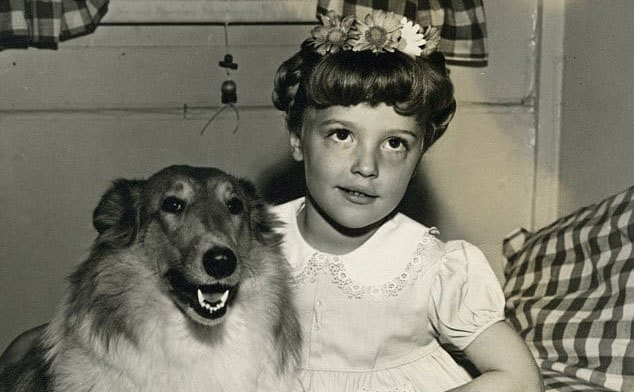 Sharon Tate as a child sitting next to her dog.