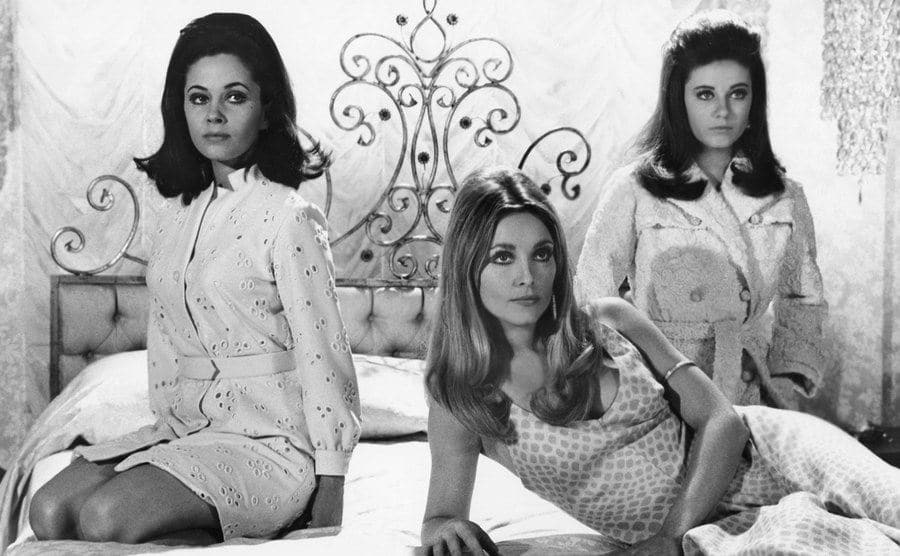 Barbara Parkins, Patty Duke and Sharon Tate sitting on a bed in Valley of the Dolls.