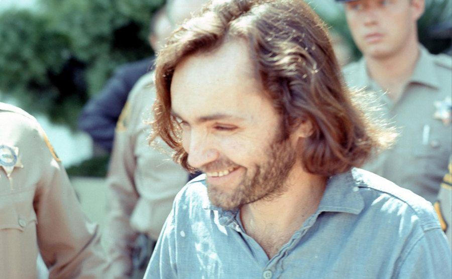 Charles Manson smiling.