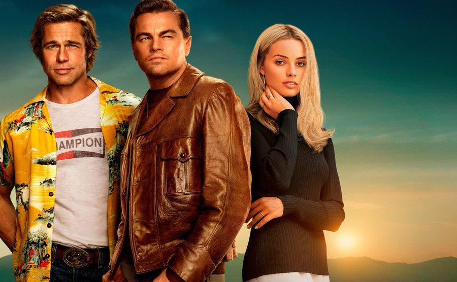 Brad Pitt, Leonardo DiCaprio and Margot Robbie posing for t he movie's poster.