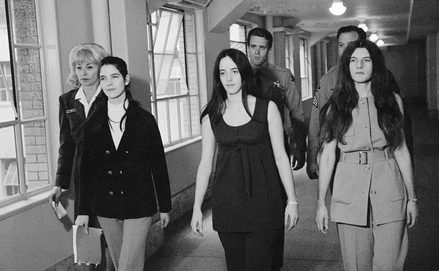 Leslie Van Houten, Susan Atkins, and Patricia Krenwinkel, return to their cells.