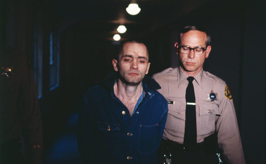 Charles Manson being led back to his cell.