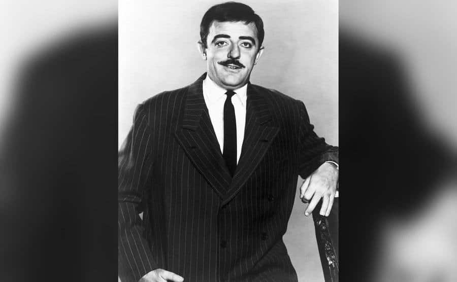 A portrait of John Astin as Gomez from