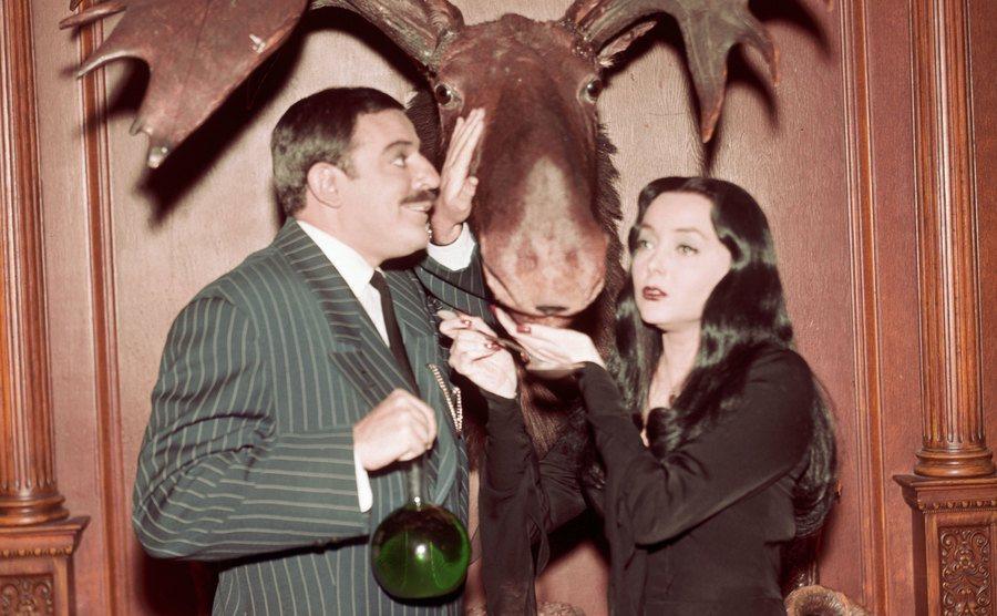 John Astin as Gomez Addams and Carolyn Jones as Morticia Addams