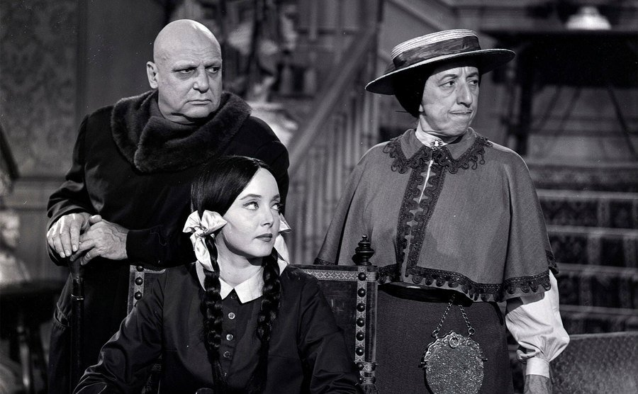 Carolyn Jones, Jackie Coogan, and Margret Hamilton in a scene from The Addams Family.