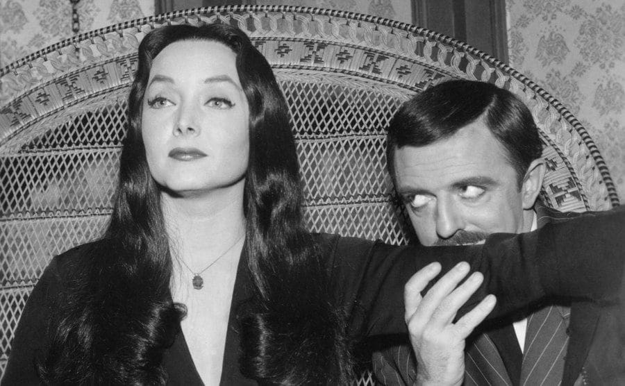 Gomez is kissing his way up Morticia's Arm.