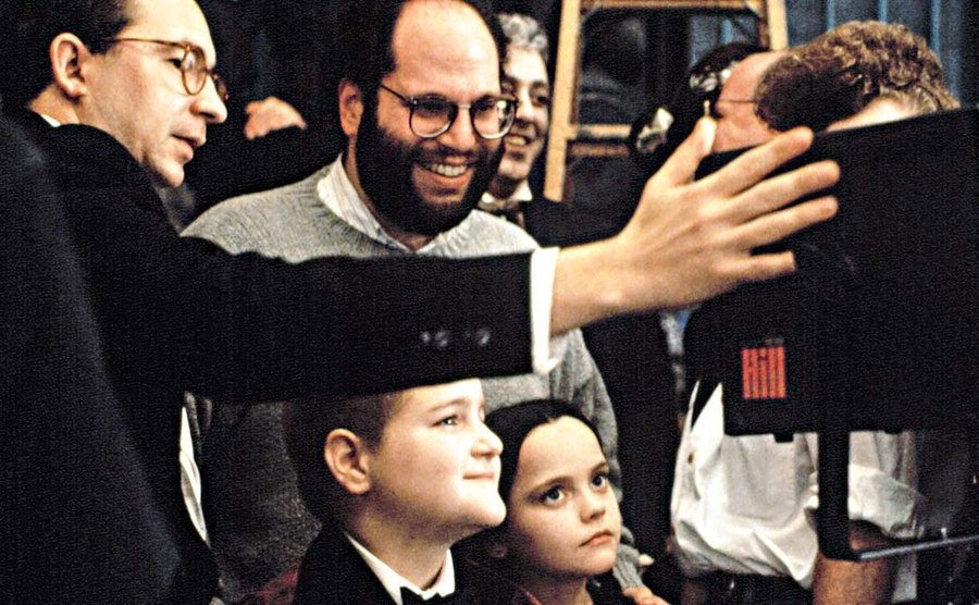 Rudin is on The Addams Family set as he watches the shot playback.