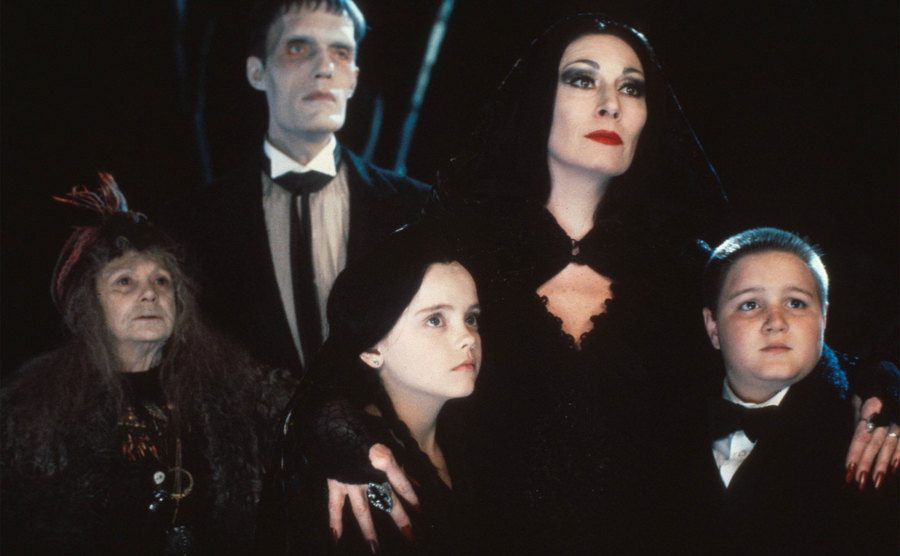 Morticia, Wednesday, Pugsley, Lurch, and Grandma in a scene from The Addams Family.