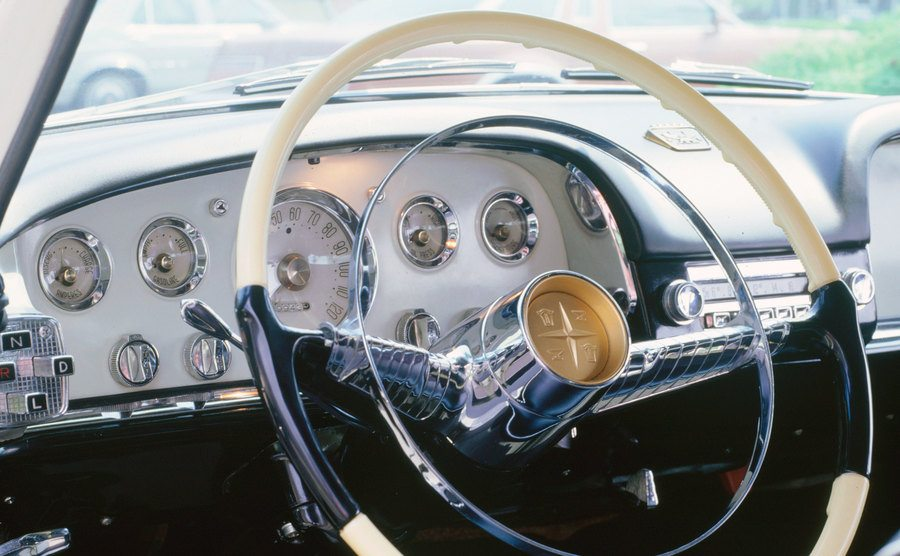 A view of a steering wheel in a car.