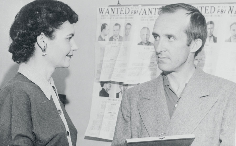 Nannie Doss' employers look at her picture at the police station.