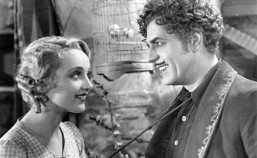 Carole Lombard and Warner Baxter in the Arizona Kid.