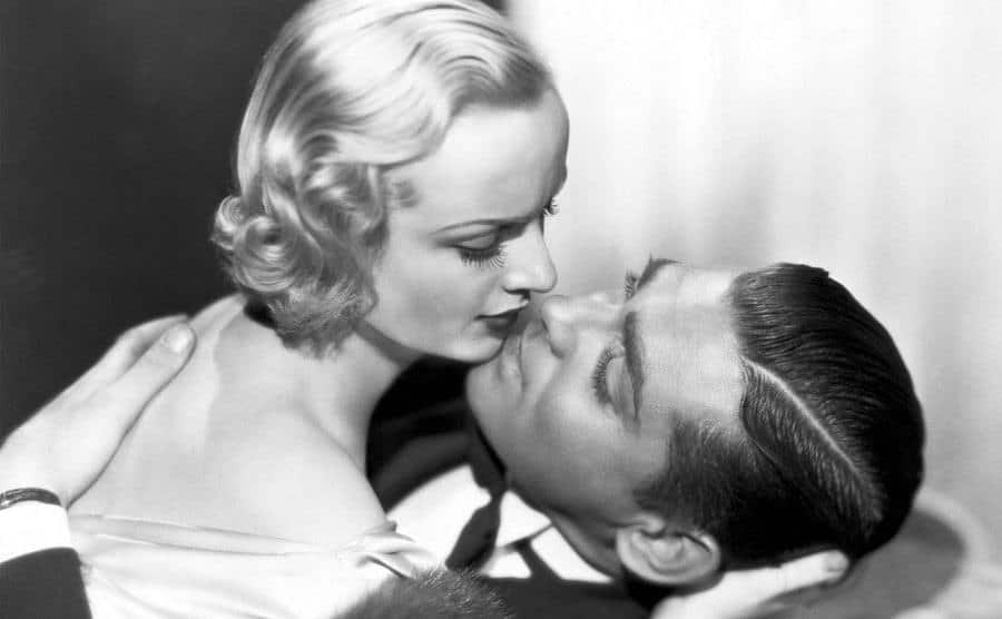 Carole Lombard and Clark Gable embrace in a scene from the film
