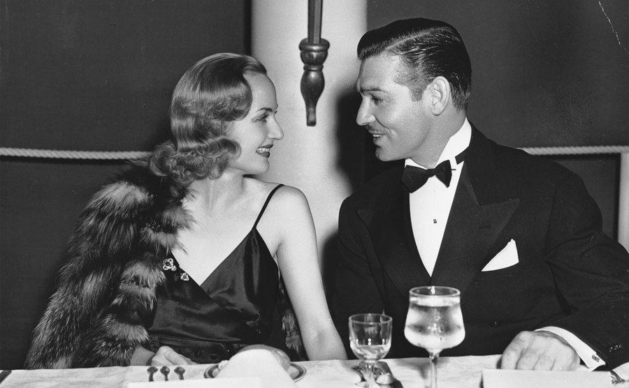 Gable and Lombard sit beside each other during an event.