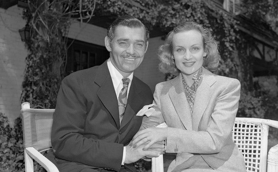 Carole Lombard and Clark Gable grin for photographers following their wedding.