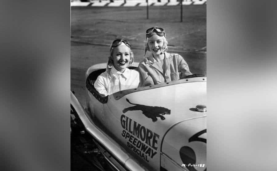Lombard and Lucille Ball drive a racecar.