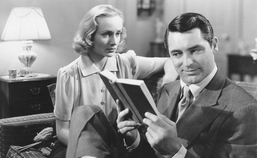 Carole Lombard and Cary Grant sit in a living room in a scene from 'In Name Only.'