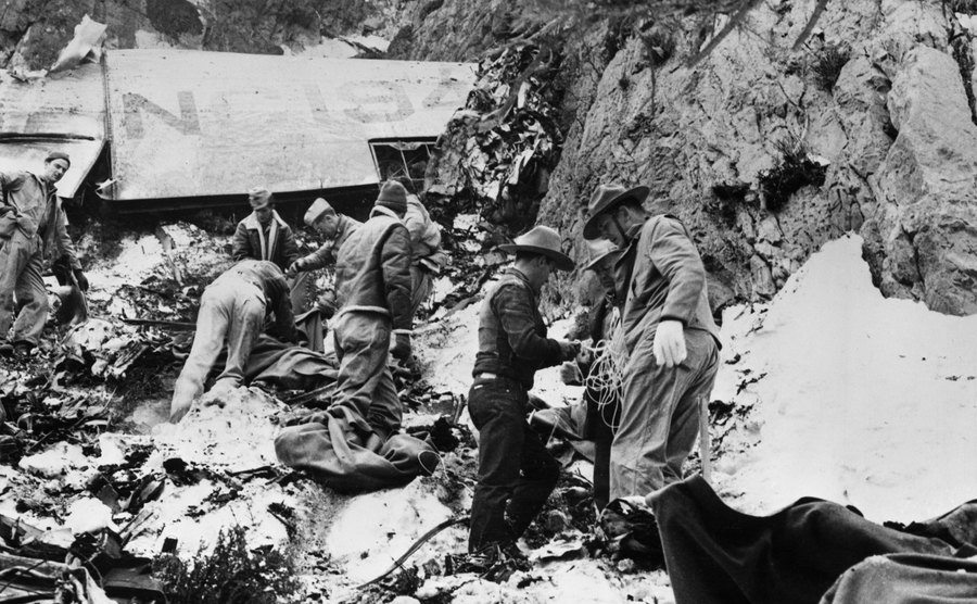 Soldiers stand near the scene of the air crash that took the life of Carole Lombard.