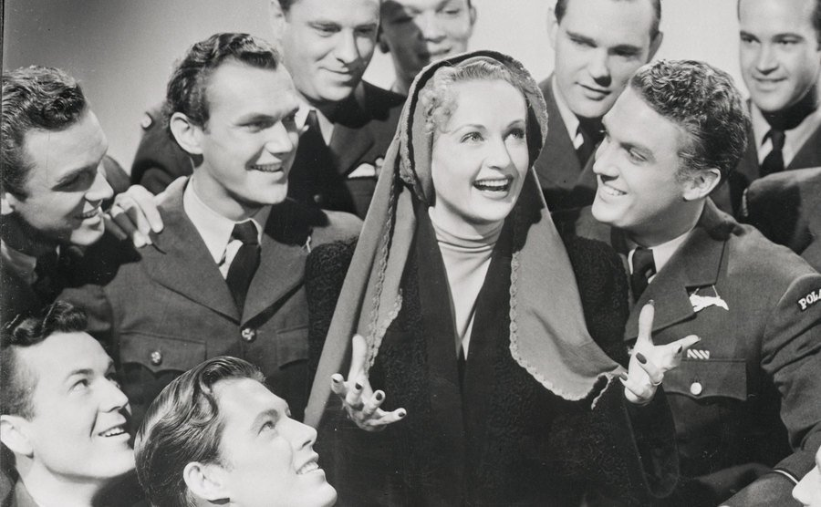 Lombard is surrounded by soldiers in a still from the film To Be Or Not To Be.