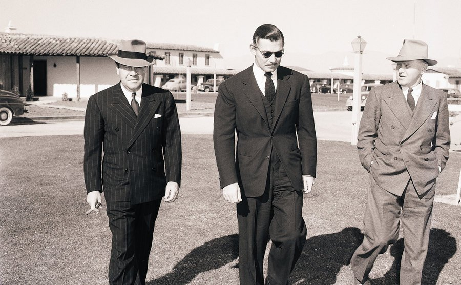 Clark Gable leaves his hotel after the notice of his wife's death.
