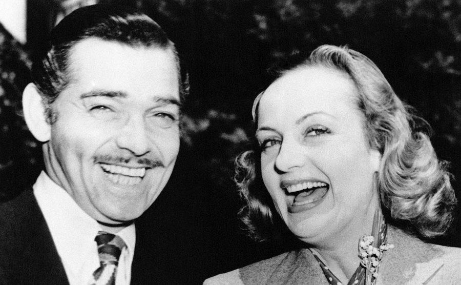 Clark Gable and Carole Lombard share a laugh.