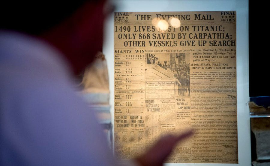 A newspaper clipping headlining the sinking of the Titanic.