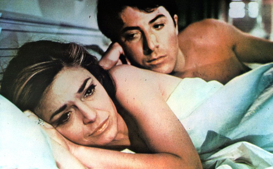 Anne Bancroft is in bed with Dustin Hoffman in the film 'The Graduate.'