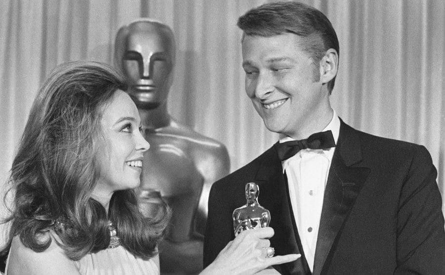 Lovely Leslie Caron presents Mike Nichols with an Oscar.