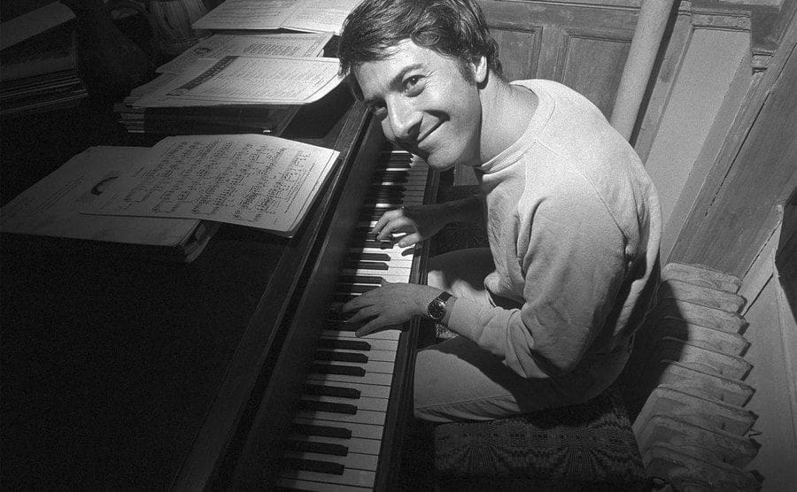 Dustin Hoffman plays his piano at home.