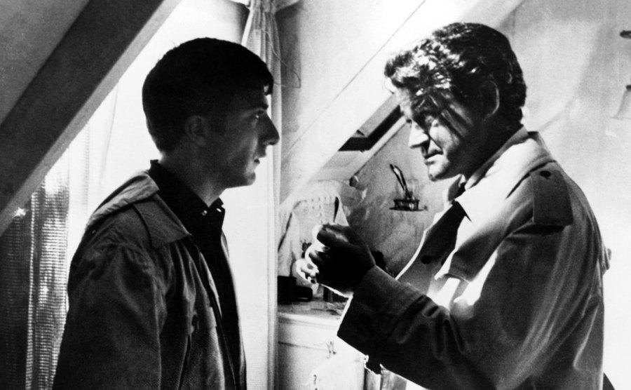 Dustin Hoffman as 'Ben Braddock' and Murray Hamilton as 'Mr. Robinson' in the film 'The Graduate.'